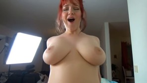 Hot busty redhead takes a ride