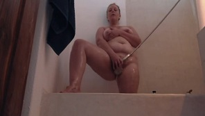 Chubby milf babe has fun in shower!