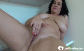 Amateur mature with huge tits fingers herself