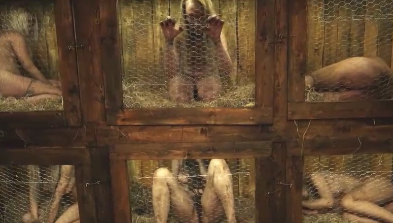 Horror Porn - Crazy man inmates young girls in cages.