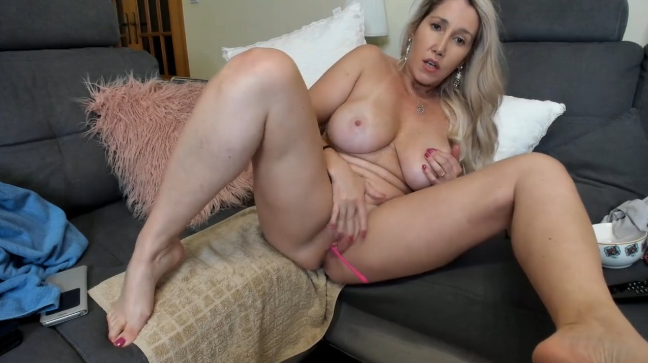 Blonde milf plays with her shaved pussy